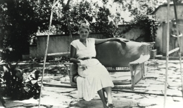 <em>Ruth Reed in the garden on the south side of the Byrne-Reed House. Courtesy of the Reed family.</em>