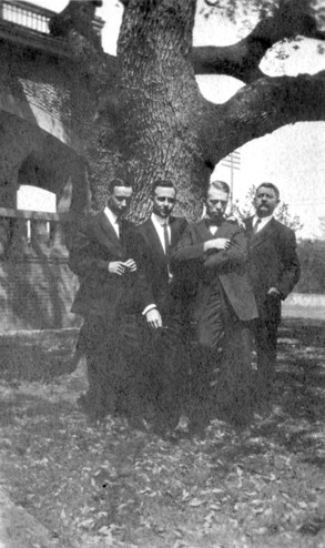 <em>Photograph of Byrne family men around the Live Oak tree that is still growing on the south side of the Byrne-Reed House. Courtesy of Tom Reynolds.</em>