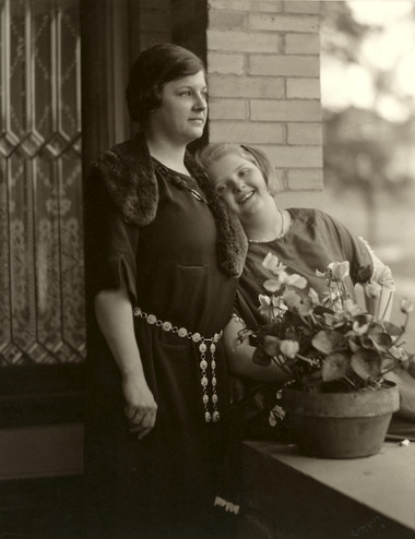 <em>Photograph of Laura and Ruth Reed by the front entrance to the Byrne-Reed House. Courtesy of the Reed family.</em>