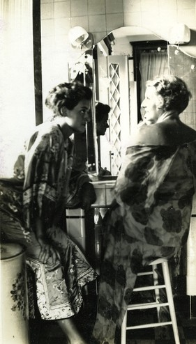 <em>Unidentified women in what is believed to have been the east, second-floor bathroom. Courtesy of the Reed family.</em>