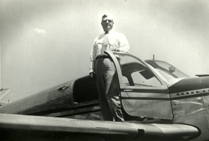 <em>David Reed poses by his plane. Courtesy of the Reed family.</em>