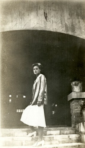 <em>Unidentified woman on the stairs at the south entrance to the Byrne-Reed House. Courtesy of the Reed family.</em>