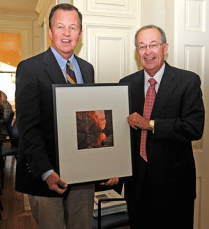 Joe Krier and Julius Glickman. Glickman is presenting Krier with a Bill Wright photograph to thank him for his service to the board.