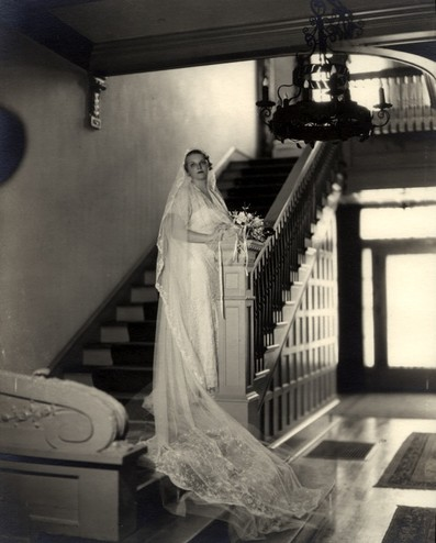 <em>Portrait of Ruth Reed on the staircase in the gallery of the Byrne-Reed House on her wedding day in 1934. Courtesy of the Reed family.</em>