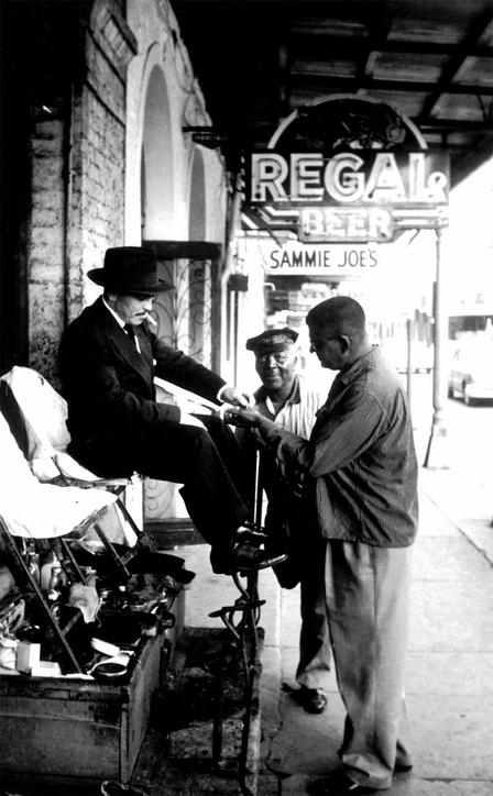 Griffin working at a shoeshine stand