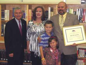 Mark LaCroix (right) with family (center) and State Rep. Tom Craddick (left).